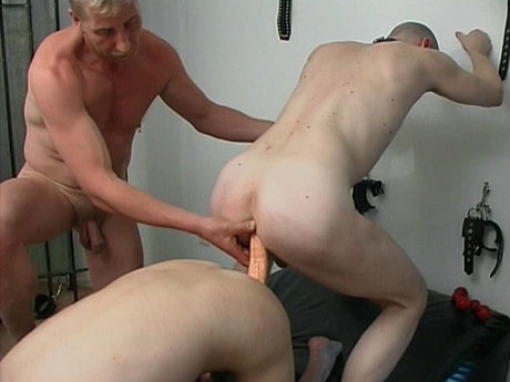 Gay Fetish Sex : Doing his gay slaves with double strap-on!